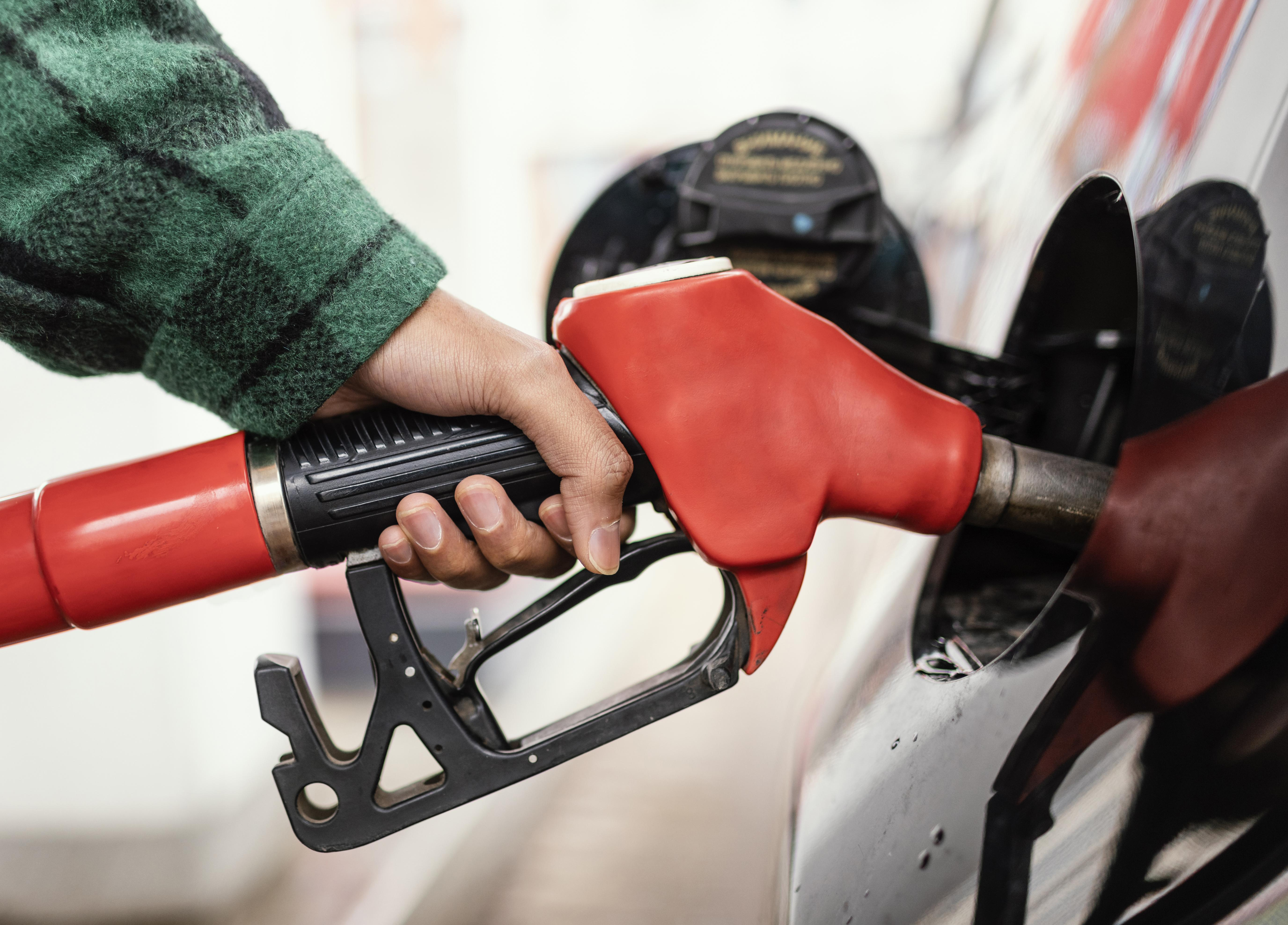 man-at-gas-station-with-the-car-close-up